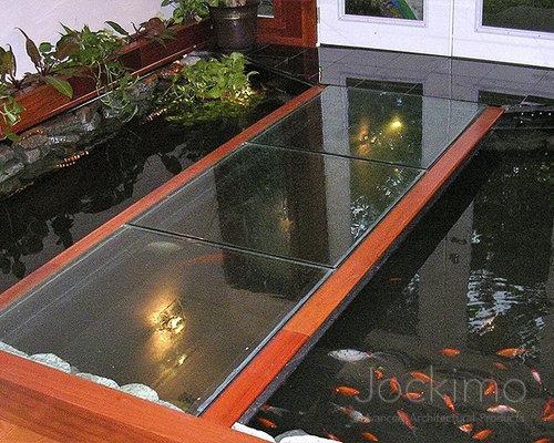 Glass Floor Over Koi Pond Inside Of Home