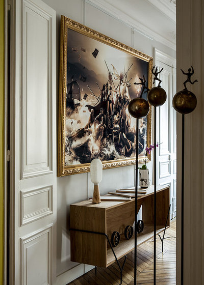 Art comment accrocher ses tableaux sans les fixer au mur for Accrocher miroir au mur
