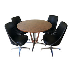 four swivel bucket seat chairs and a round pedestal base dinning table