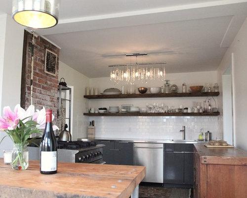 Cuisine avec un plan de travail en inox cr dence briques - Metro cuisine professionnelle ...