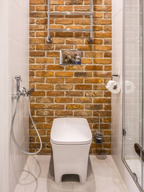 ... toilet, ceramic tile, red walls, ceramic floors and white cabinets
