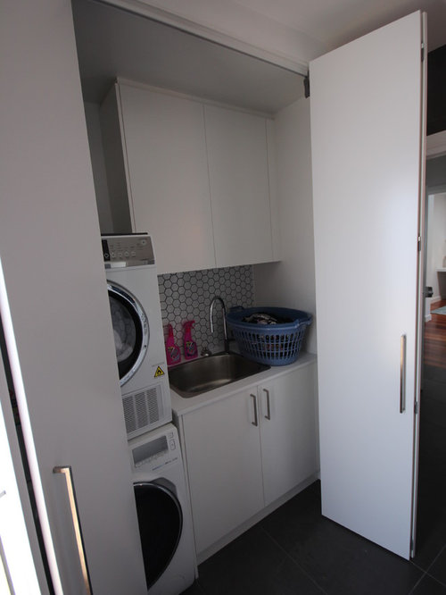Countertop Materials For Laundry Room : Mid-sized modern single-wall dedicated laundry room idea in Melbourne ...