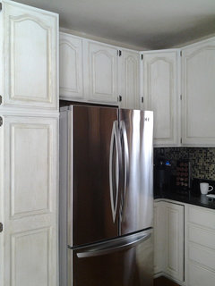 Should I paint my custom, solid wood kitchen cabinets?