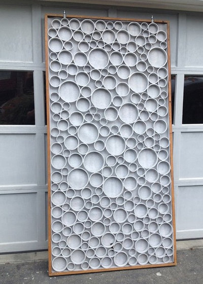 A designer uses pvc pipe to cast a modern garden gate for Pvc pipe art ideas
