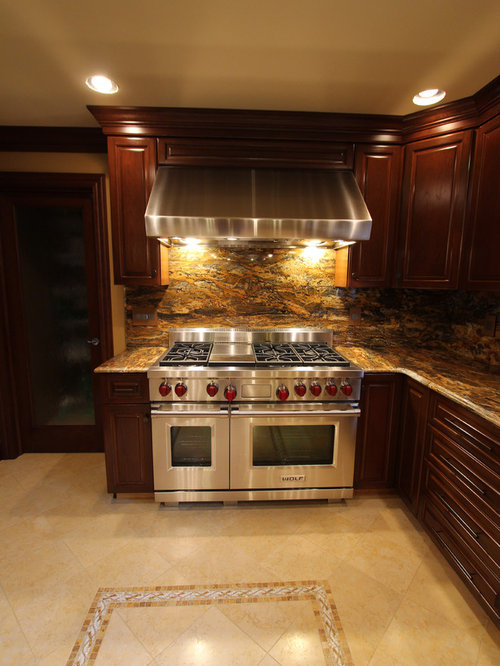 Traditional kitchen with cherry cabinets granite for Traditional kitchen appliances