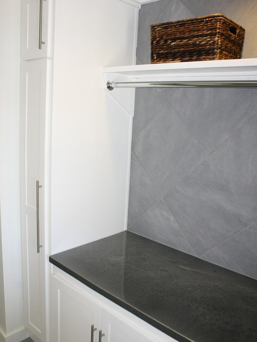 Laundry Countertop Materials : ... white cabinets, concrete countertops, white walls and porcelain floors