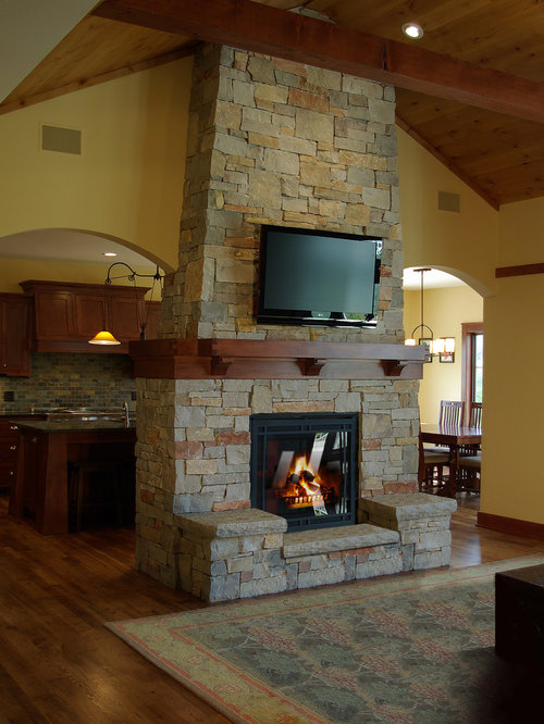 room design ideas renovations photos with a two sided fireplace