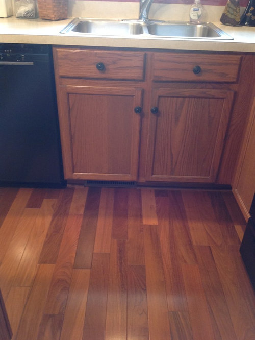 Gingersnap Maple Cabinets With Beige Quartz Countertop