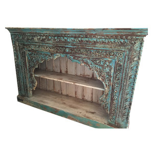 Mogulinterior - Consigned Indian Blue Bookshelf Arched Frame Patina Carved Wood - Rustic hand carved bookcase from India made from an antique door frame that was salvaged from the Havelis of Rajasthan with a warm rustic patina that defines character and age.The texture of teak wood is naturally rich and ages exceptionally well .The shelves and the sides are made from reclaimed sheesham wood which is also a hardwood of the teak family.The crown molding has been done in a step down design and adds a finishing touch to the rustic character of the bookshelf.