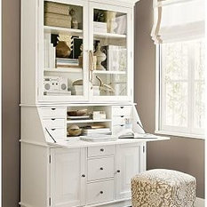 ; the space below desktop features three drawers, and two cabinets ...