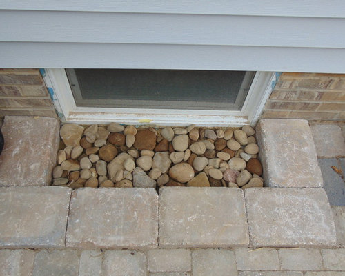 Patio With Natural Stone Steps Seating Wall And Low