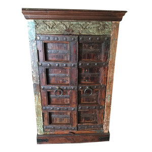 Mogulinterior - Consigned Home Decor Armoire Cabinet Reclaimed Antique Vintage Patina Storage - Dark Brown Rich with culture the cabinet doors belong to the British raj as well as imbibes the rustic charm from old India.The carving on the cabinet door are door from the tradition of vastu culture which is the Indian art of the interior design . This amazing furniture is made of reclaimed shutters and antique elements from Jodhpur, Rajasthan, India!