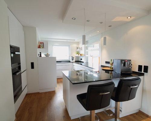 Contemporary open plan kitchen design ideas renovations photos with black appliances - Modern kitchen with black appliances ...