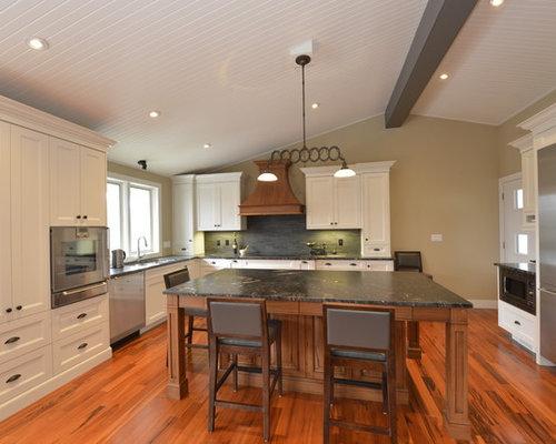White kitchen cabinets granite countertops home design for Best mid range kitchen cabinets