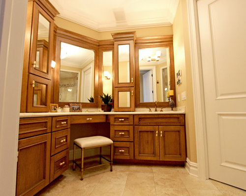 Cherry cabinets in masterbath with matching mirrors for Bathroom interior designer newcastle