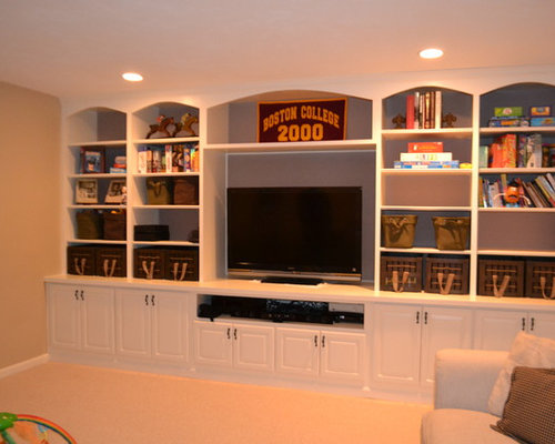 Mid-sized elegant fully buried basement photo in Boston with beige ...
