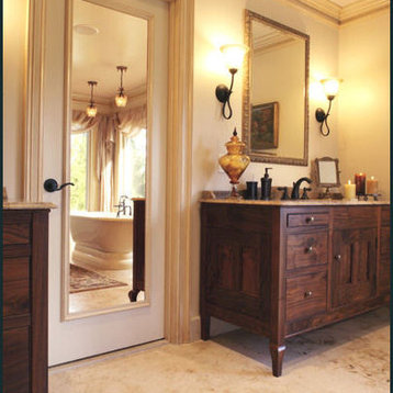 ... beveled framed mirror between the two custom walnut lavatory cabinets