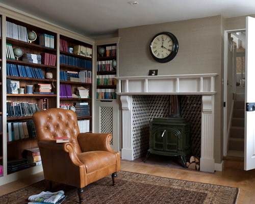 Study Home Office Design Ideas, Remodels & Photos with a Wood Stove and Light Hardwood Floors