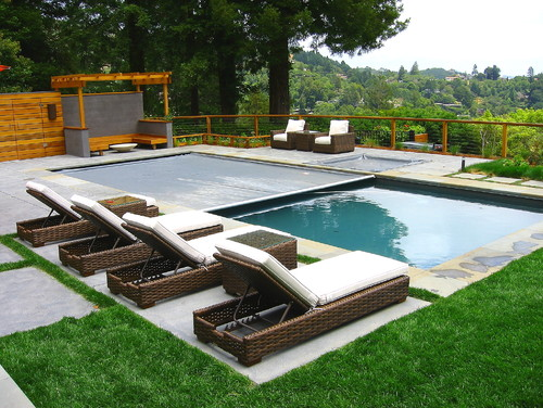 An Automatic cover with softer material on this rectangular pool. These kinds of covers can be quite convenient when they work, taking the stress of having to manually cover the pool off of you.