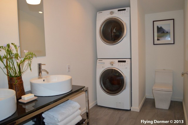 Attic bedroom transformed into contemporary bathroom for Small bathroom designs with washer and dryer