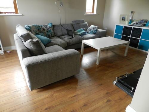 how far under my sofa should a rug go. Black Bedroom Furniture Sets. Home Design Ideas