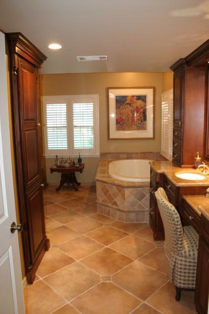 Elegant master bath with warm rich tones traditional for Elegant master bathroom designs