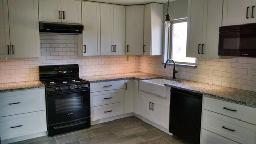 POLL white cabinets, black appliances, granite and ORB cabinet pulls