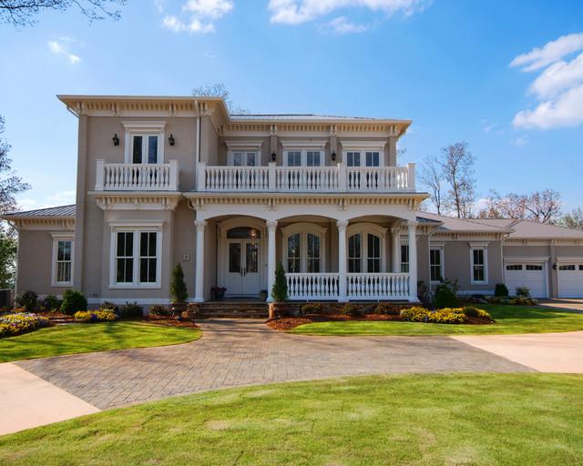 mountain top italianate front daylight custom home design gallery