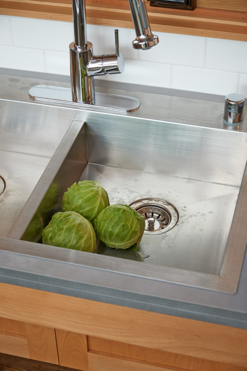 The kitchen sink is shallow enough to accommodate someone using a chair.
