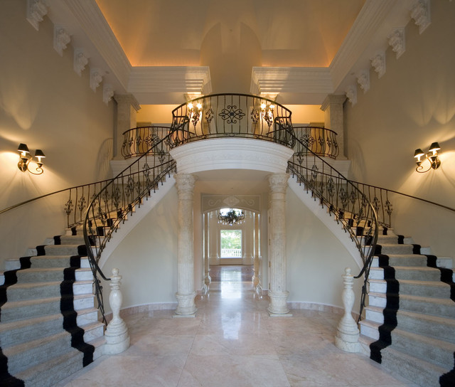 Classical grand foyer double staircase for a mediterranean for Double curved staircase