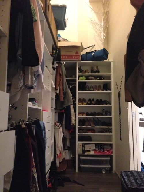 Dark narrow walk in wardrobe with super high ceilings!