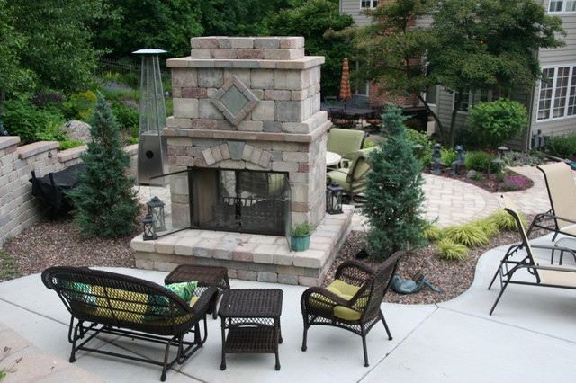 sided outdoor fireplace rustic milwaukee by
