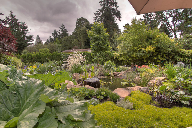 Natural pond traditional portland by paradise for Paradise restored landscaping exterior design
