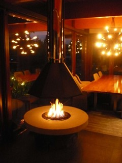 Outdoor Fire Pit With A Suspended Hood