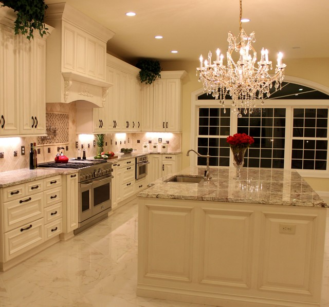Luxurious Kitchen w Antique White Cabinetry & Sienna Bordeaux Granite