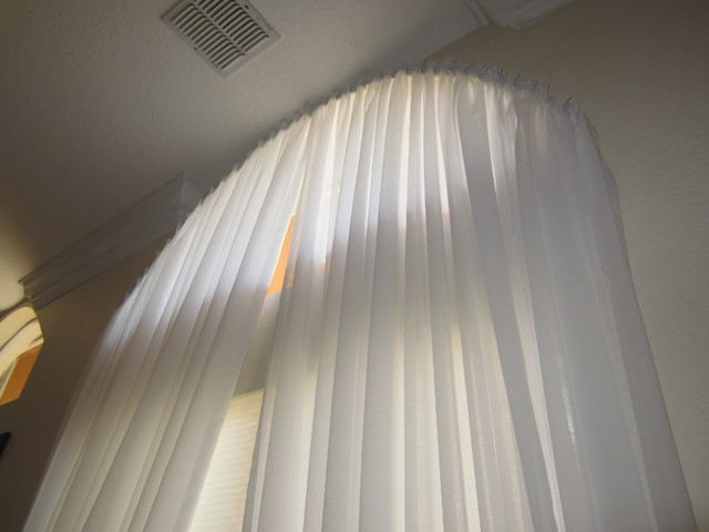 Yardena arch window with pleated white sheer drapes modern curtains