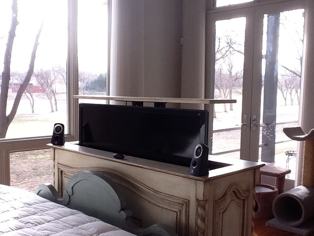 TV lift cabinet at end of bed by Cabinet Tronix