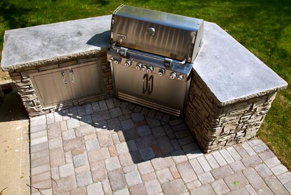 grill island featuring vertical stamped concrete omaha