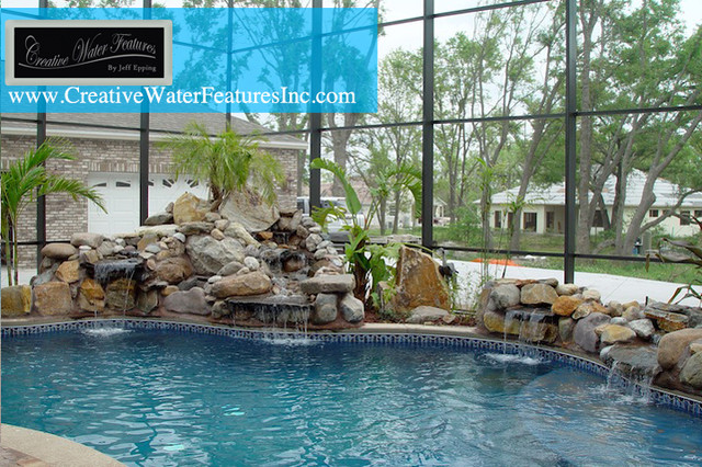 Waterfall wrapped around pool orlando by creative for Pool design orlando