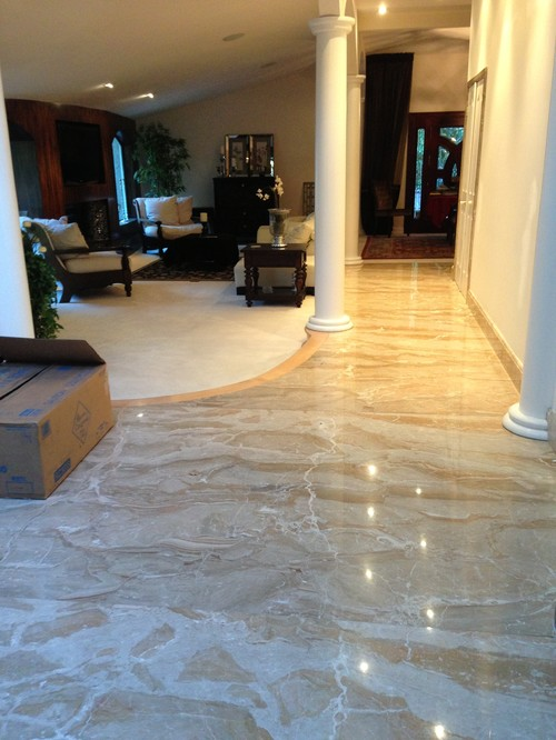 Can I cover this marble floor with wall to wall sisal?