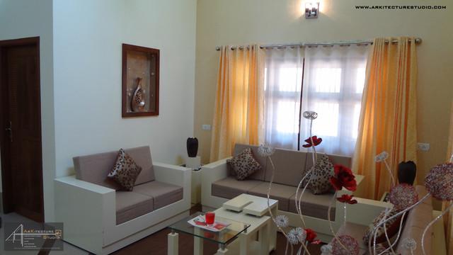 Arkitecture studio exterior and interior designers calicut for Modern living room in kerala