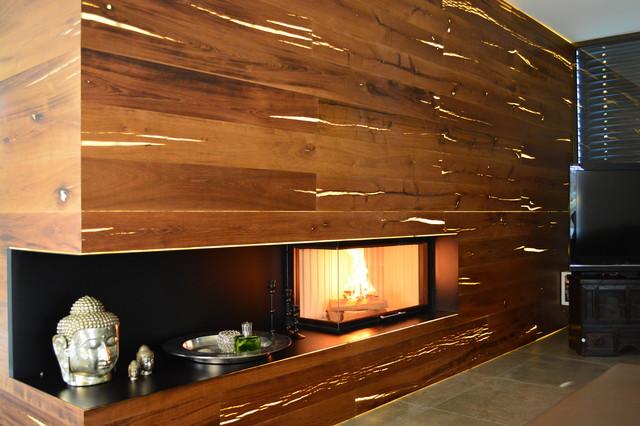 kamin mit hinterleuchteter holzverkleidung modern stuttgart by thomas lorenz kachelofen. Black Bedroom Furniture Sets. Home Design Ideas