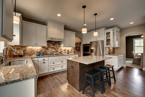 White kitchen cabinets and Santa Cecilia Granite countertop