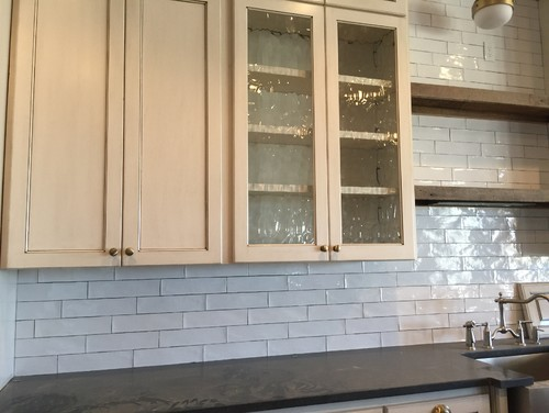 ivory cabinets with white backsplash