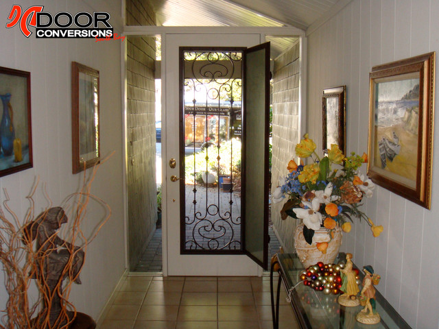 Wrought iron door insert hinged safety glass screen included front doors san francisco for Exterior door with glass and screen