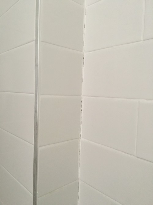 Grout cracking in shower corners