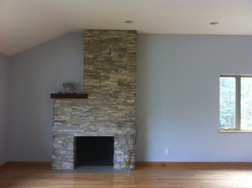Furniture layout around tall fireplace in an l shaped for L shaped living room with fireplace