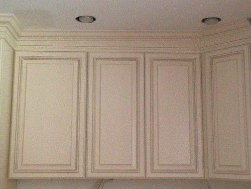 installing crown molding on cabinets with uneven ceiling 3