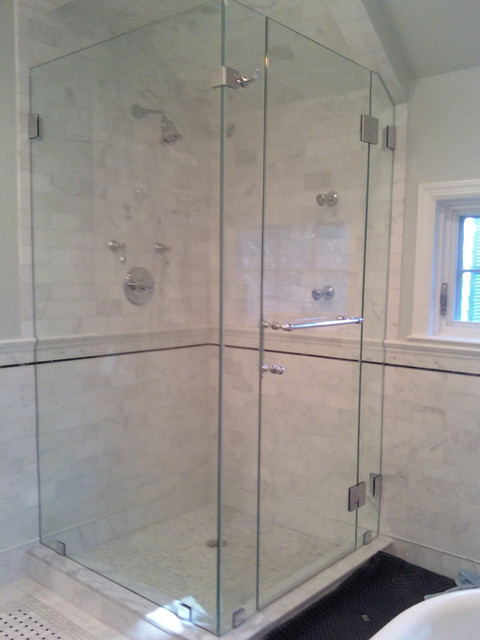 Fully frameless glass shower enclosure with angled ceiling for Fully enclosed shower
