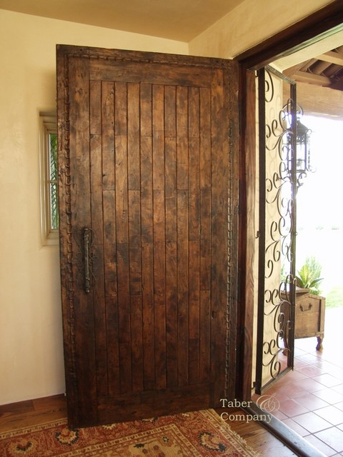 Spanish style solid wood entry door with hand carving for Mediterranean style entry doors